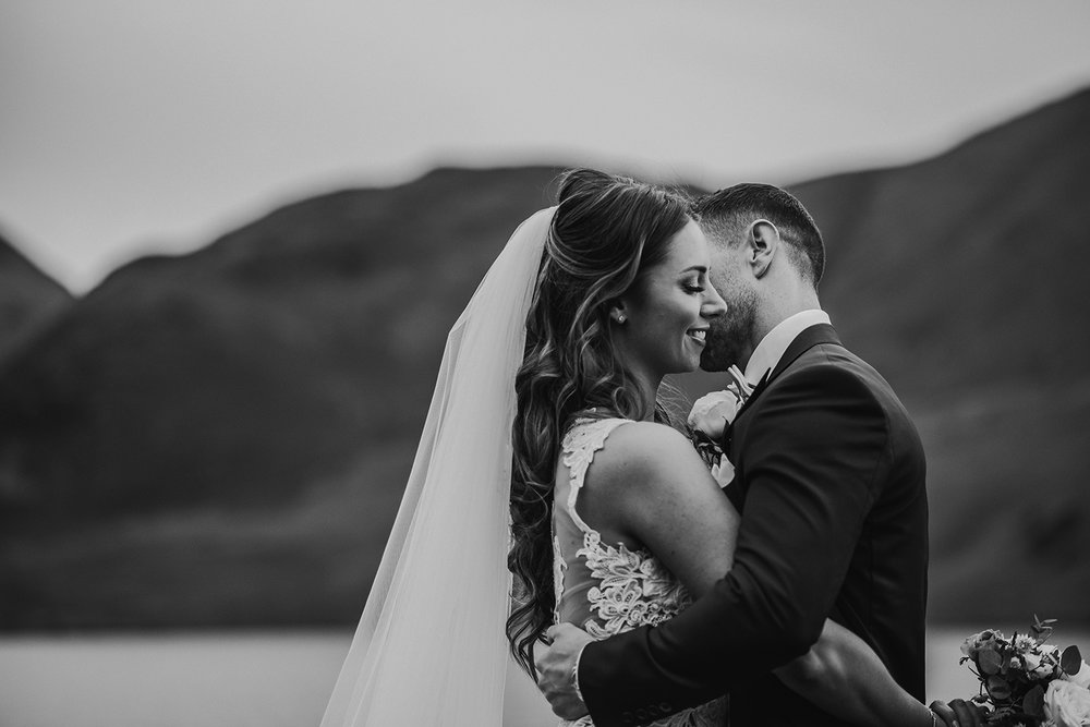 bw photo, bride and groom by the lake