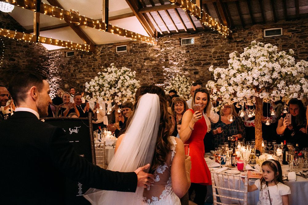 bride and groom enter the wedding reception