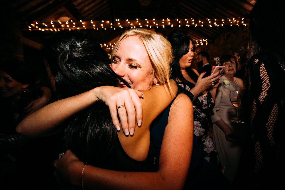 guests hugging on the dance floor
