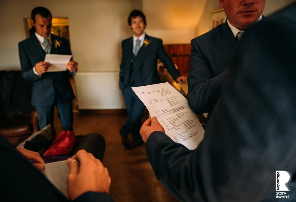the groomsmen checking the schedule for the day