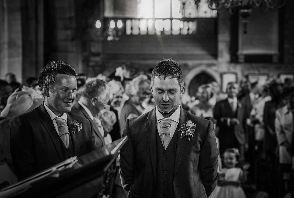 bw photo of a nervous groom