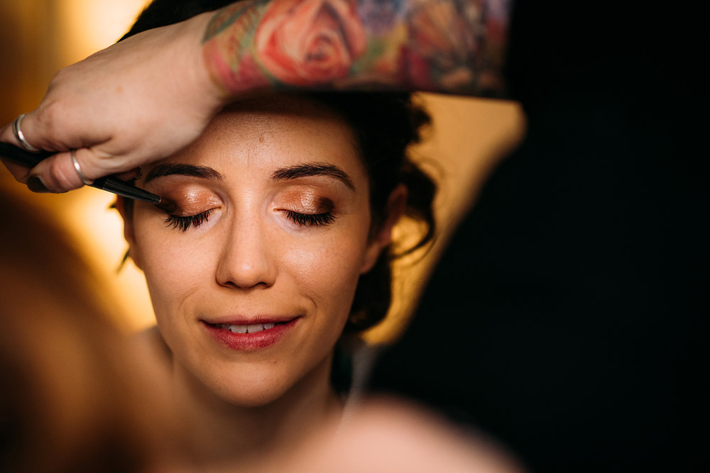make up shot framed by a tattooed arm
