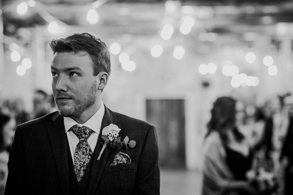 BW photo. Nervous groom waiting at the front of the ceremony room