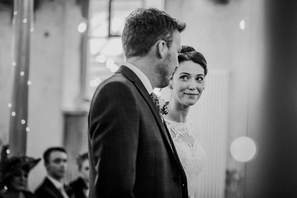 BW photo. Close up of the bride looking at her groom