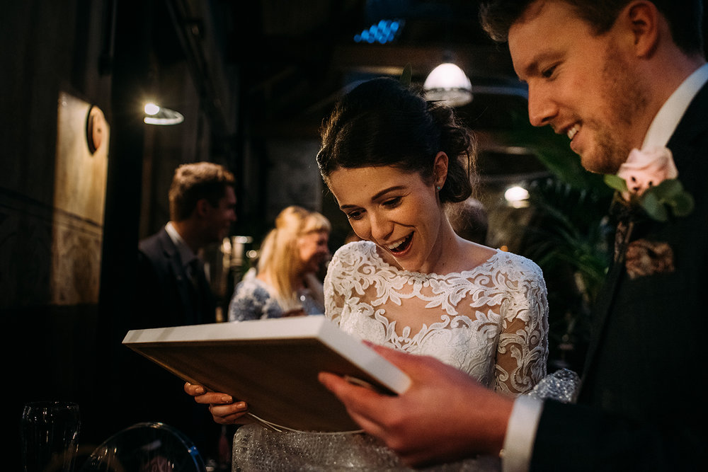 bride and groom looking at a gift they have just received