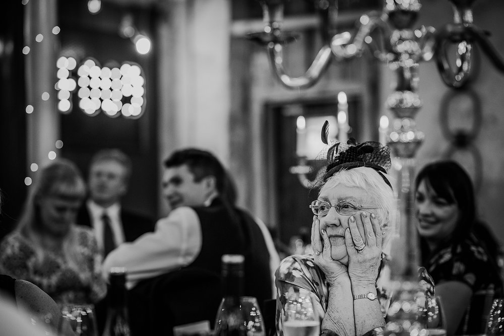 Brides grandmother listens to tribute to her late husband