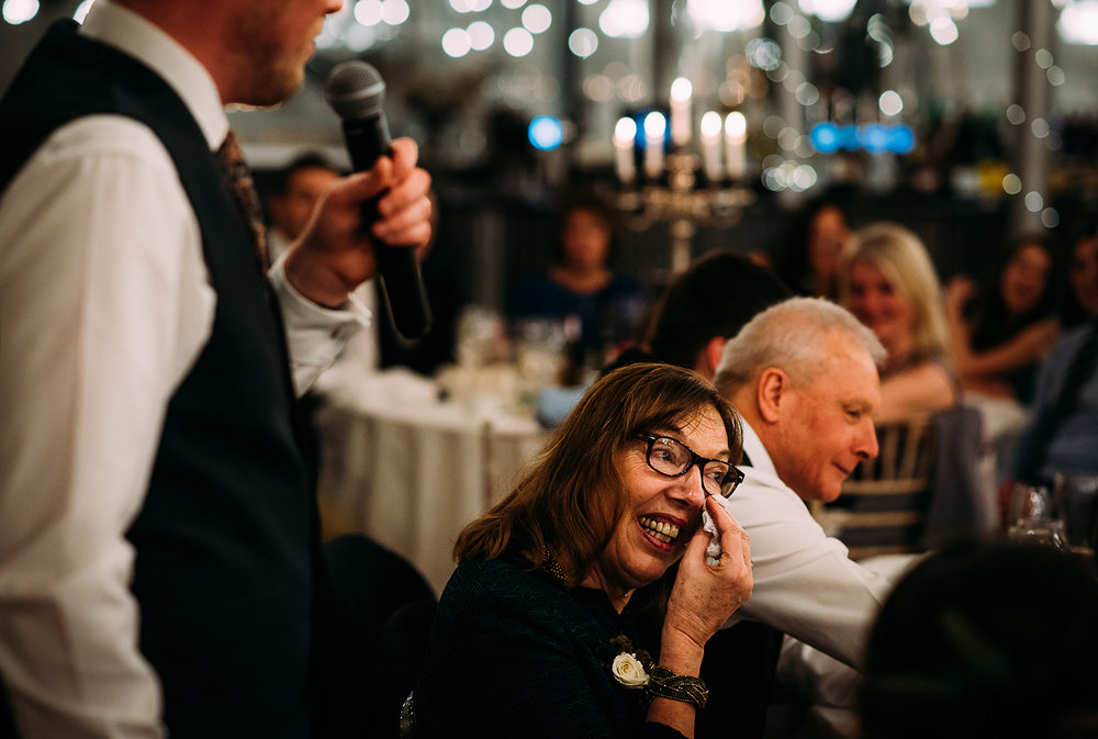 grooms mother wipes her eyes