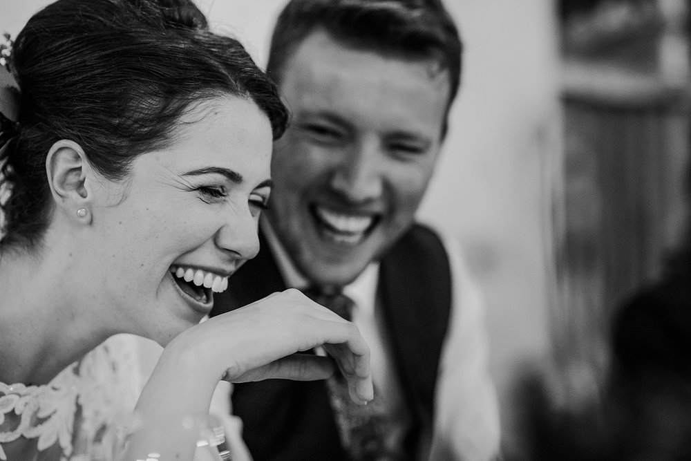 BW photo, bride and groom really laughing