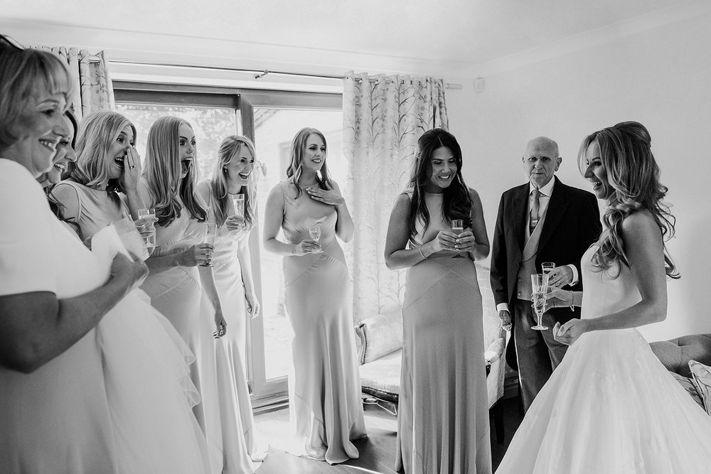 bridesmaids reaction to the bride in her dress