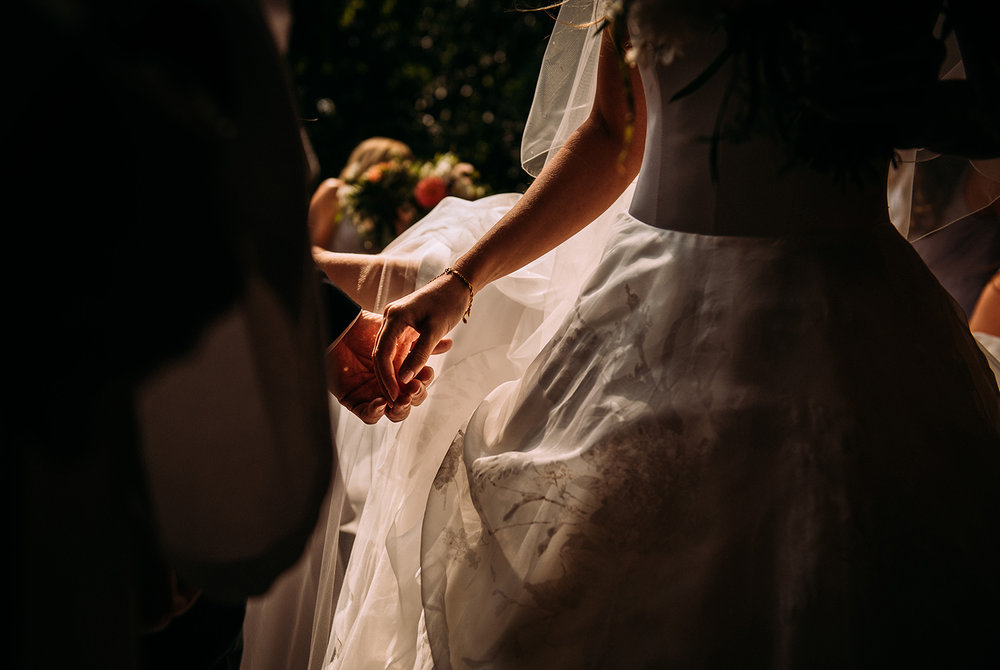 nicely lit shot of brides father letting go of her hand