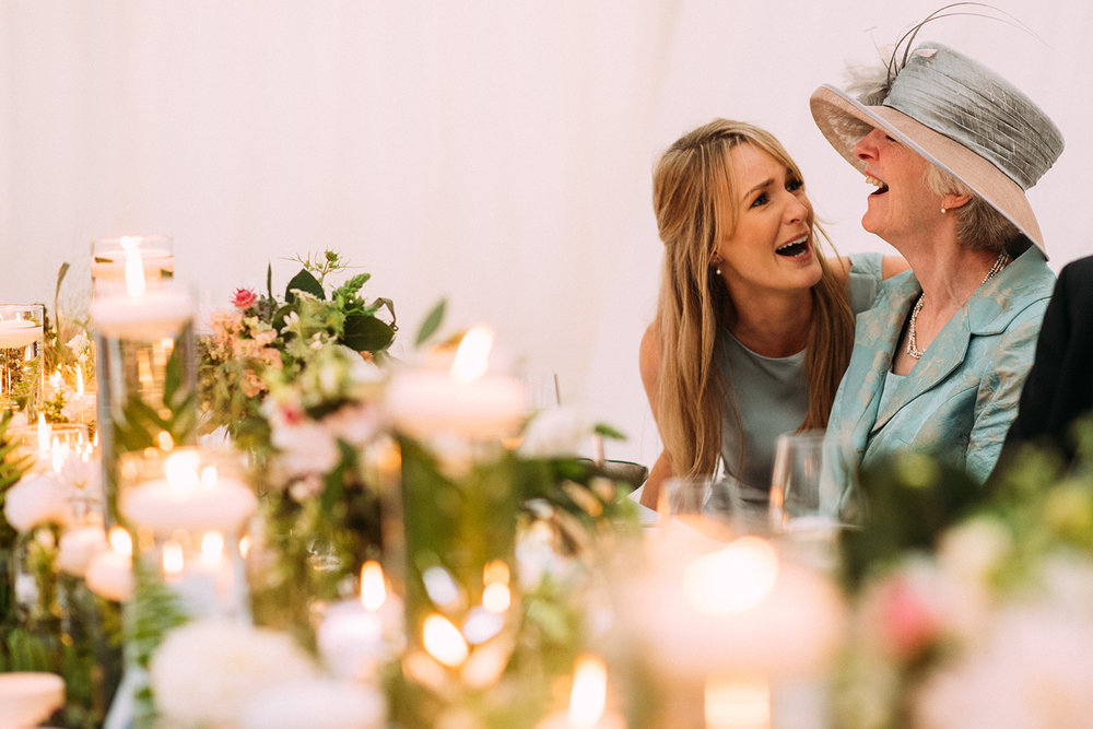 grooms mother and sister laughing together