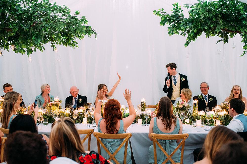 wide shot of the grooms speech