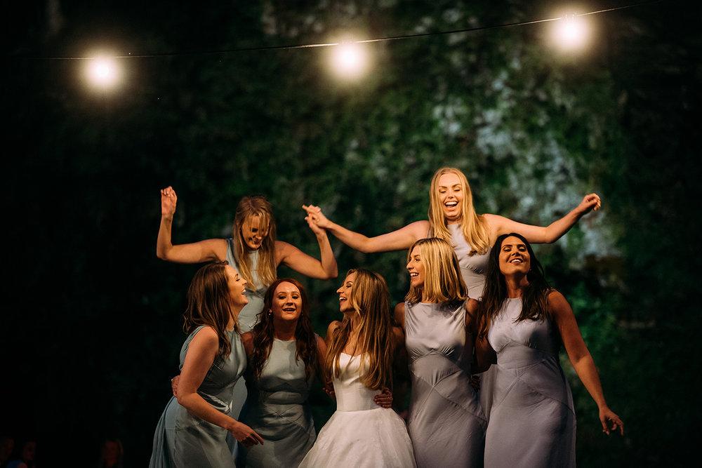 bridesmaids party under festoon lights
