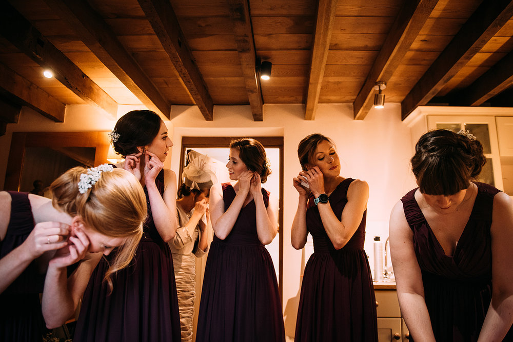 bridesmaids putting in their earrings