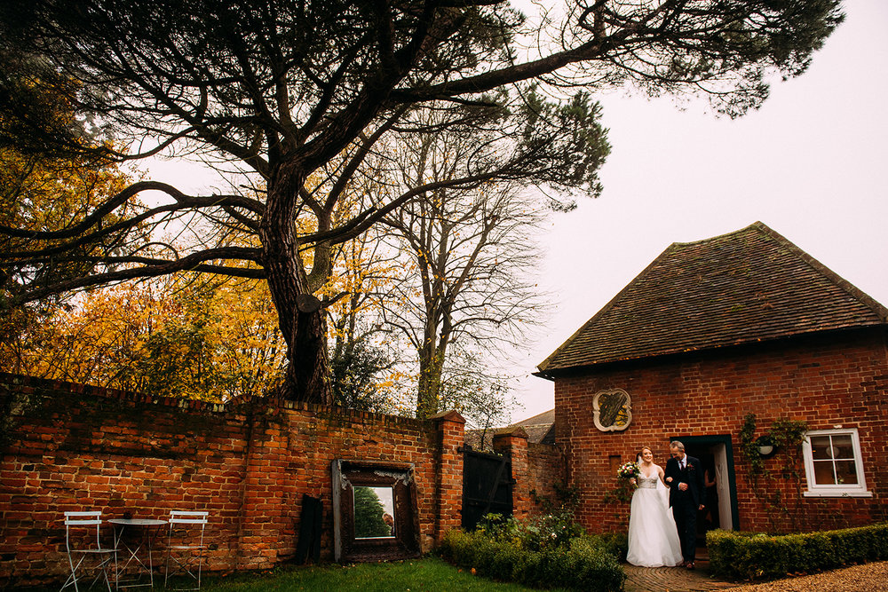 bride and father coming out of the apple loft cottage