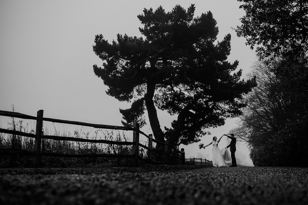 BW photo of the couple dancing under the tree