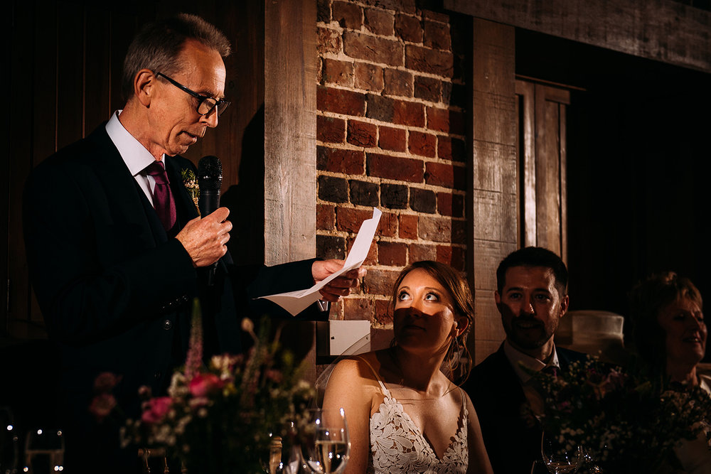 bride looking at her dad during the speeches