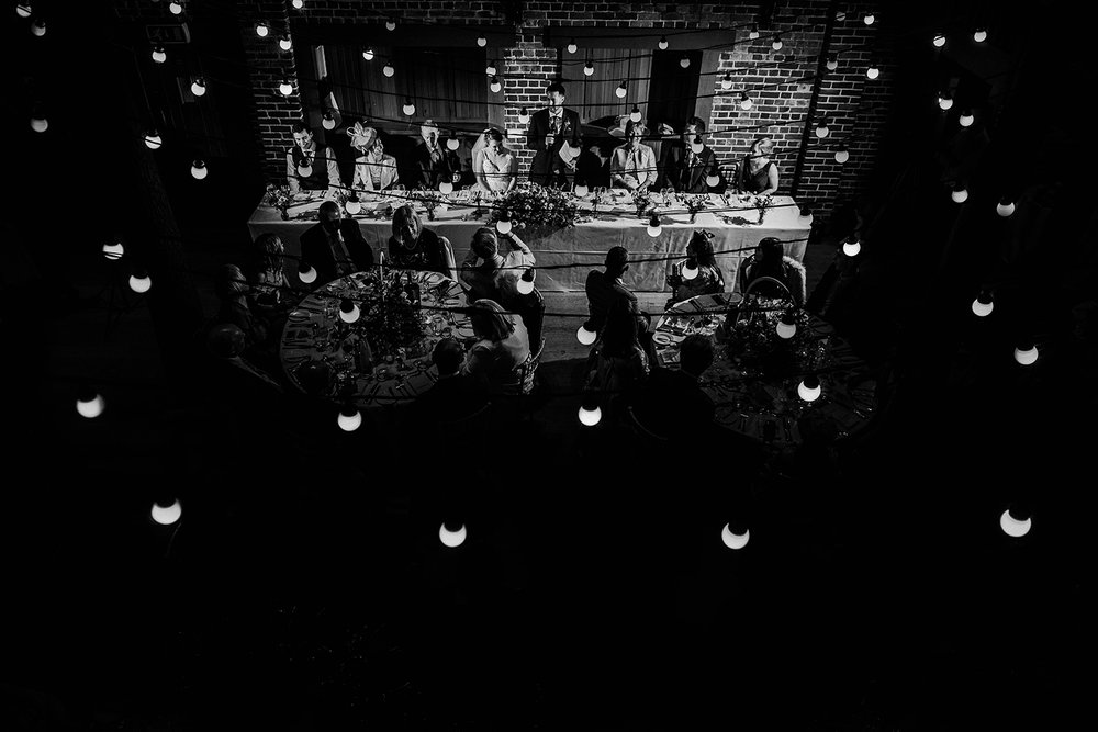 speeches shot from above through the lights. BW photo