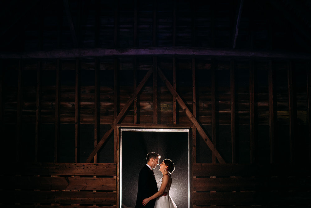 night time couple portrait in the barn