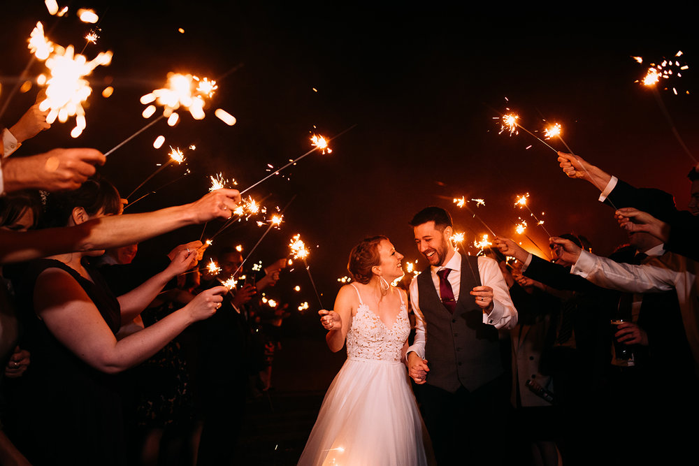 the couple during a sparkler shot at the end of the party