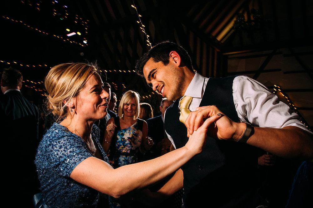 bridesmaid and husband dancing
