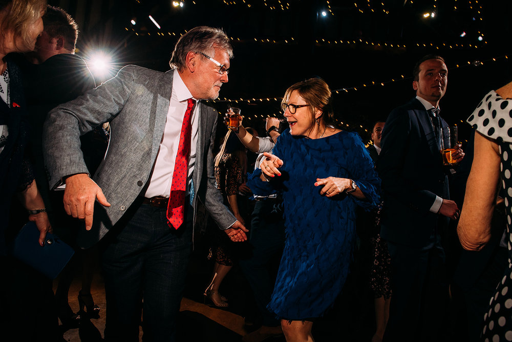 mother of the bride dancing with a friend
