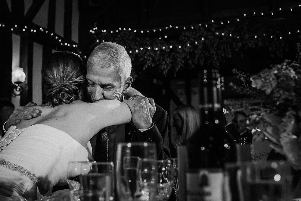 bw photo of the bride hugging her dad after his speech