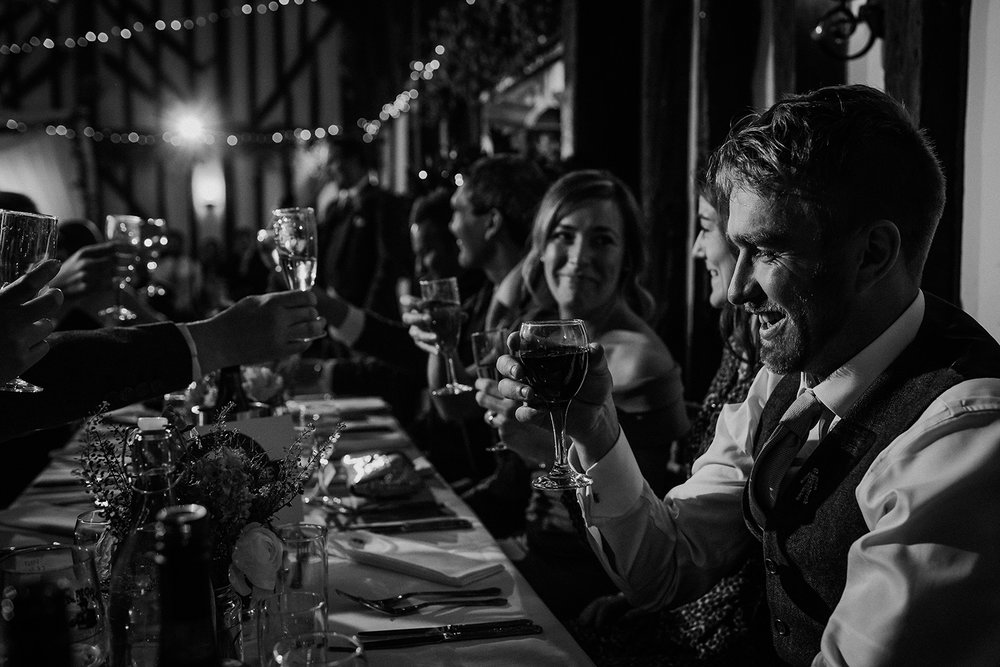 bw speech photo from the end of a long table