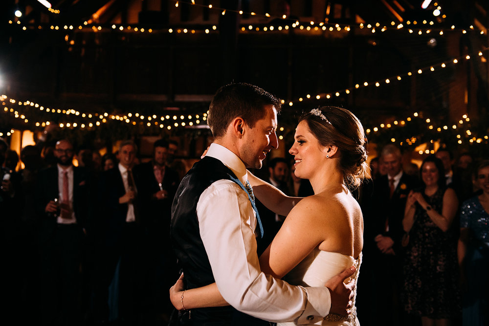 bride and groom first dance in the barn