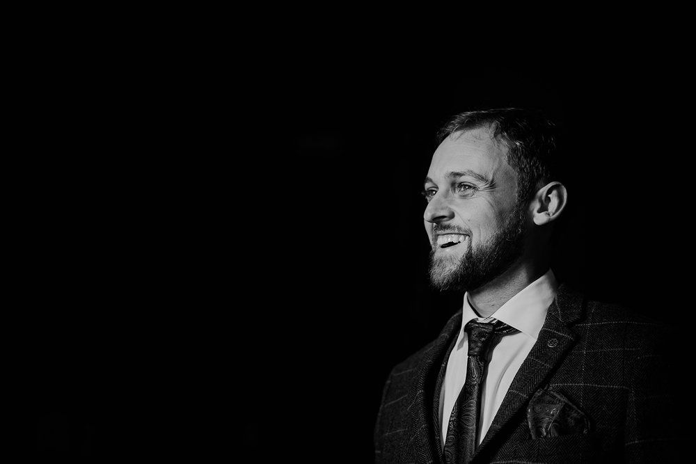 bw photo of the groom