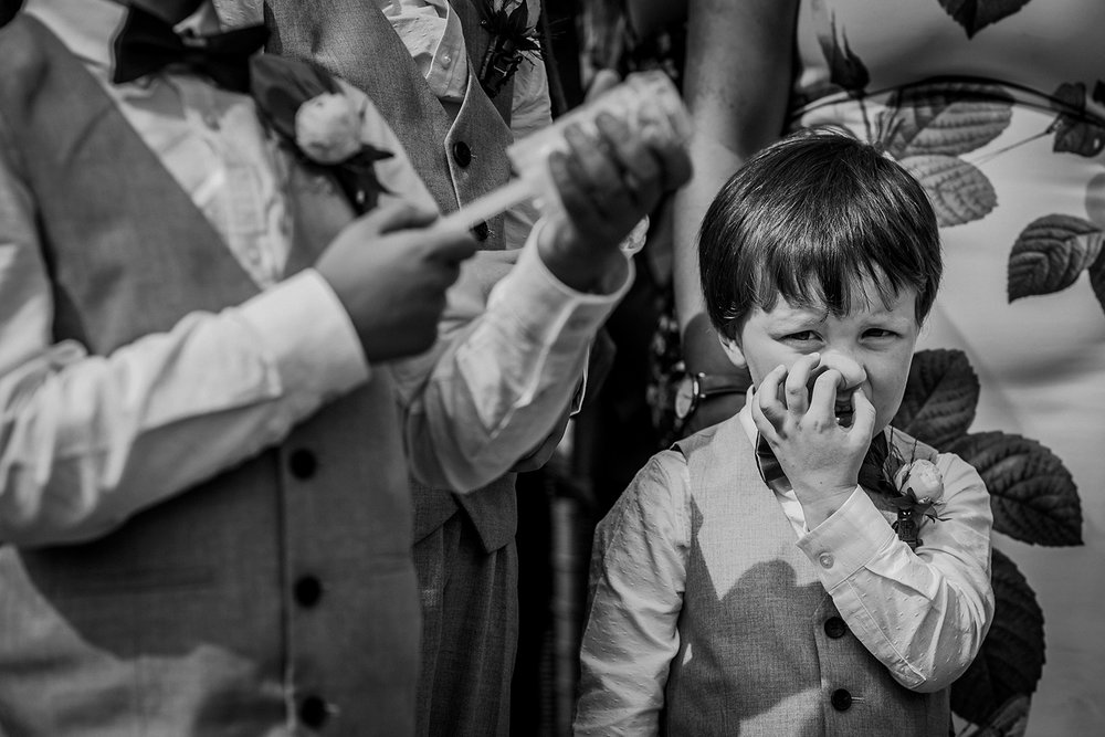 bw photo of boy picking his nose