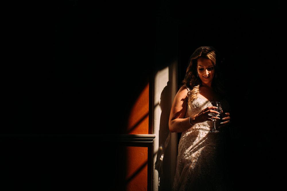bride in nice light leaving the front door