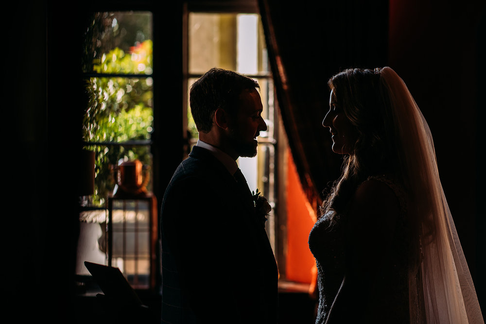 bride and groom having a quiet moment before being called into the room