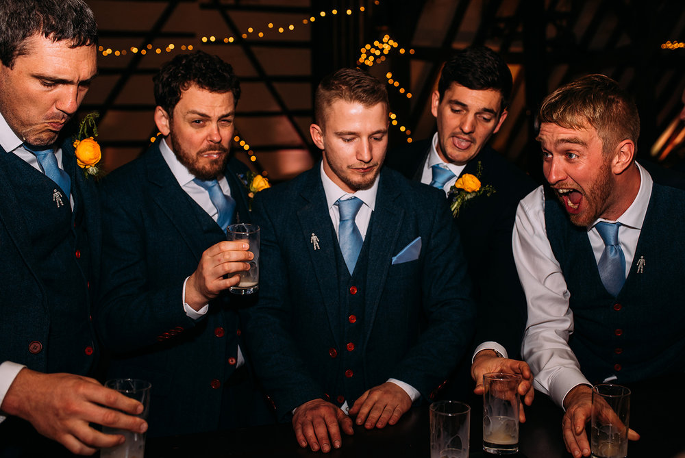 groomsmen doing shots at the bar