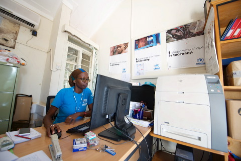 Cathy Wachiaya at work, Public Information Associate, UNHCR Sub-Office, Kakuma