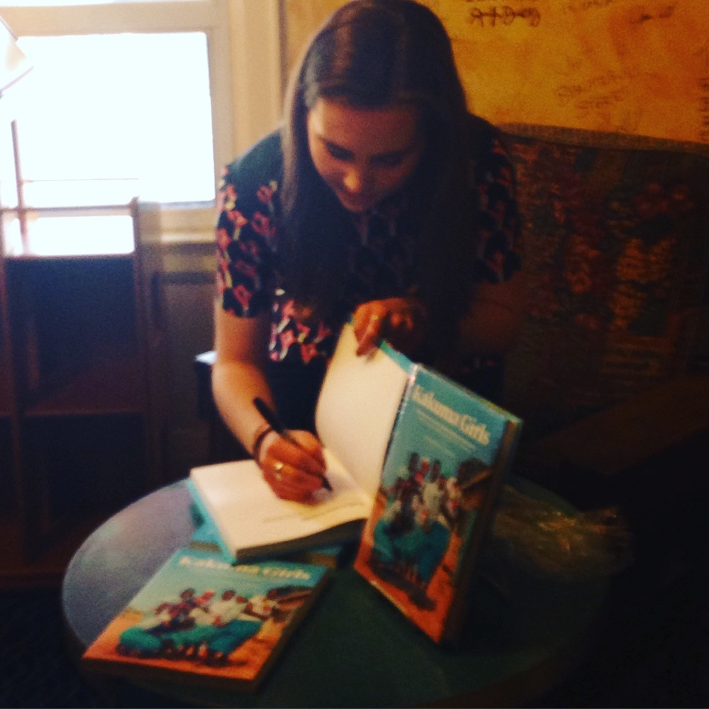 Clare signing books in Mable's Fables
