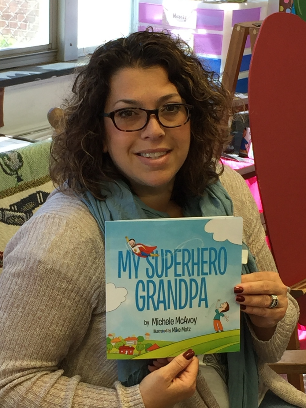 Amy read My Superhero Grandpa as the secret reader at her children's school.