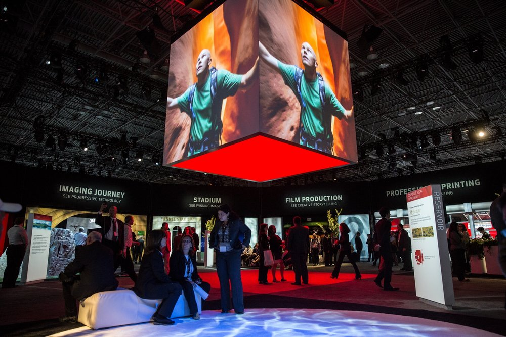 The Hub — the core of the event space, which held Canon See Impossible brand content and activations, with pathways to each product zone.