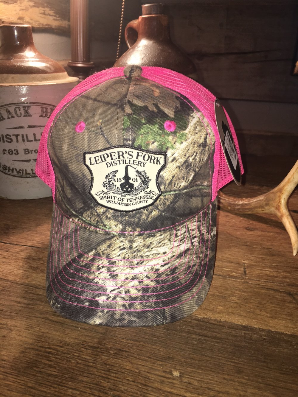 Ladies Obsession Hot Pink Mossy Oak Cap with Leiper's Fork Distillery's Main Logo
