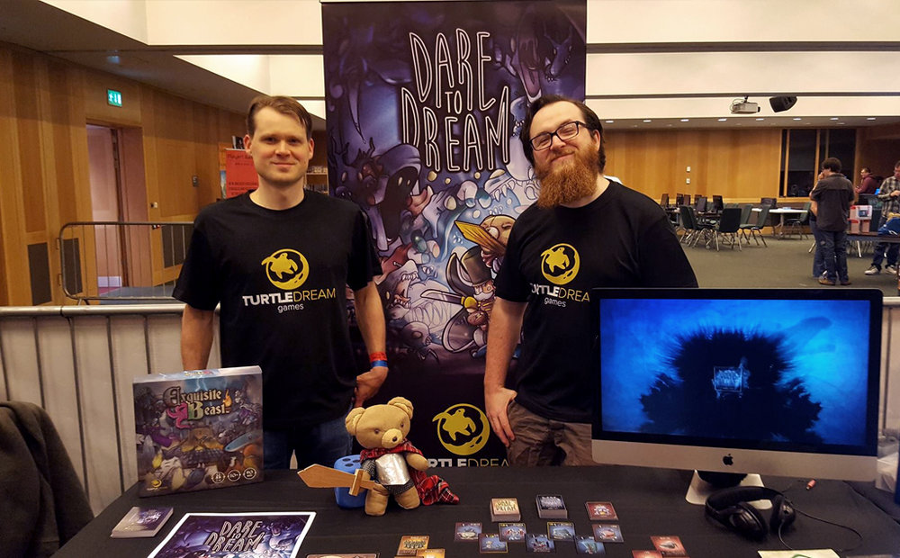 Ethan and Sean from Turtle Dream Games... that little guy in front is Theodore, aka the best mascot ever.
