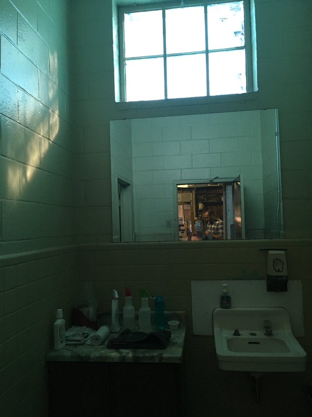 The bathroom in the current sign shop. Many of the fixtures, facilities, and features are unchanged.