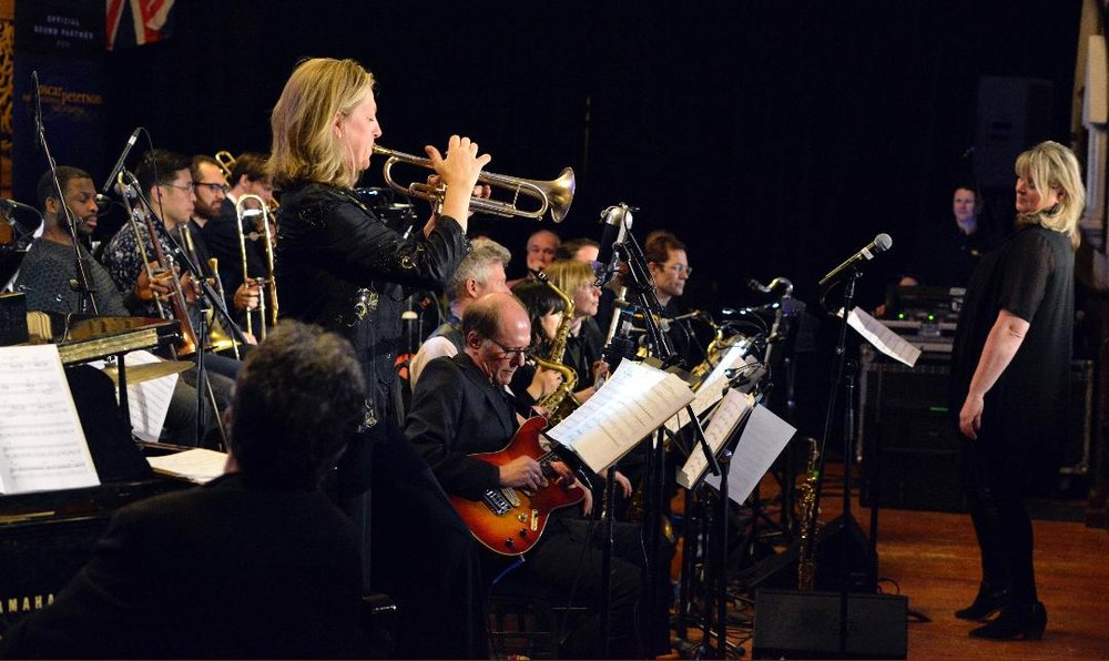 Trumpeter  Ingrid Jensen  solos with The  Christine Jensen  Jazz Orchestra at the second annual Oscar Peterson International Jazz Festival at Niagara-On-The-Lake, Ontario,
