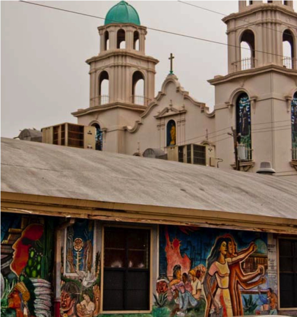 Murals seen on a school wall with St. Elizabeth Church in the background