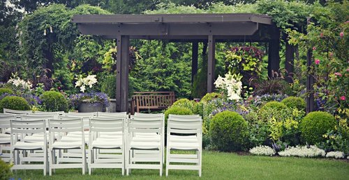 White chairs set outside on Lawn.jpg