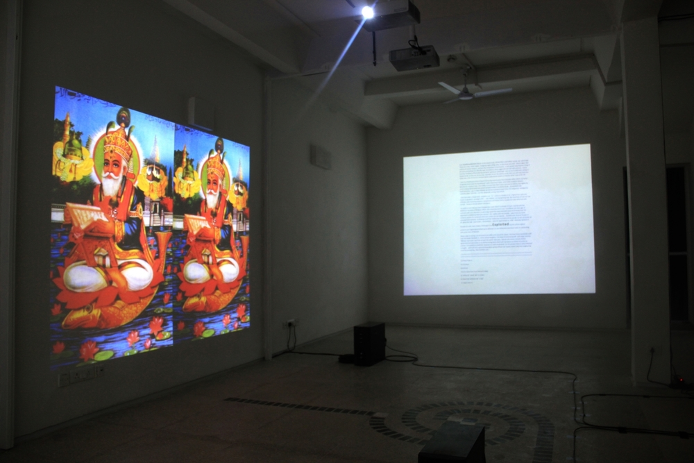 Exhibition view, to the left is Mehreen Murtaza's  This Film Should Be Played Loud  (2012) and Iqbal Geoffrey's  The Written Versus the Art Writ ( 2013). Photograph by Sadia Shirazi.