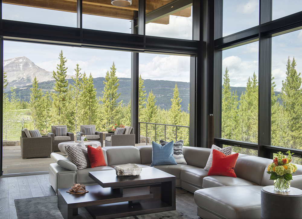 This is another   Reid Smith Architects   home.  Situated on the   Yellowstone Club   golf course, this home has amazing views of Lone Peak and the Spanish Peaks.  The walls open all the way up to the patio and the floor-to-ceiling windows are awe-inspiring.  This is a great home for entertaining!