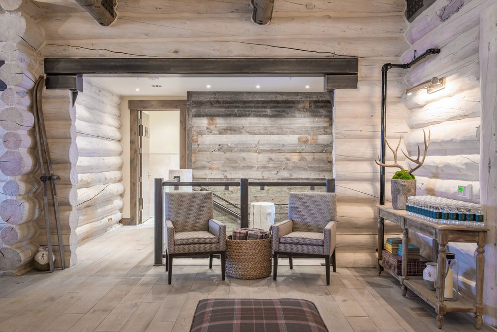 I love this shot of the front entry - a cozy space with modern touches.  The original entry was really crammed and always caused a traffic jam.  Opening the space makes the lodge feel more welcoming.