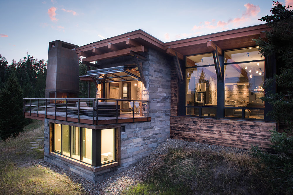 This home is stunning from all different angles.  Here you can see the large deck and fireplace.  The lower level is a greenhouse and wine cellar.  Pretty amazing!