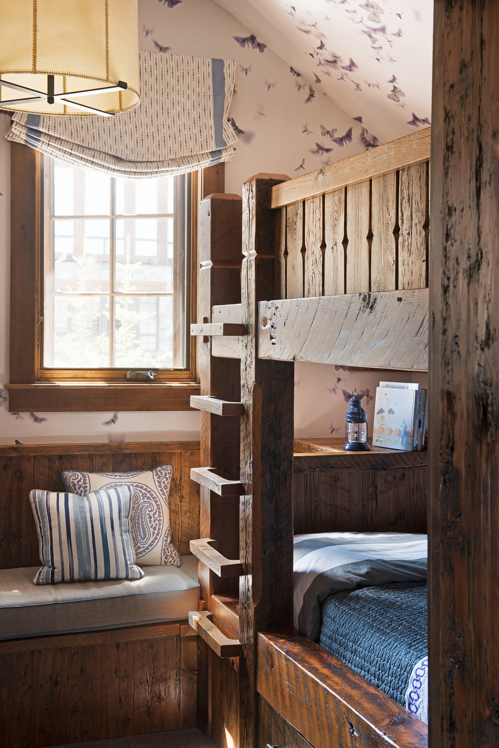 This bunkbed was custom made for this space and I absolutely love the butterfly wallpaper!