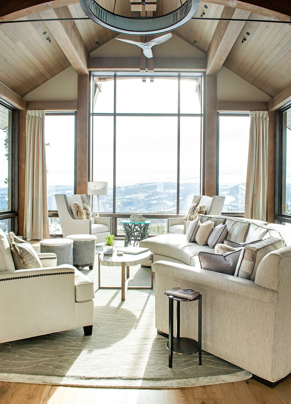 This great room is spectacular!  The large windows overlooking the surrounding mountains are complemented perfectly with the light & cozy furnishings!